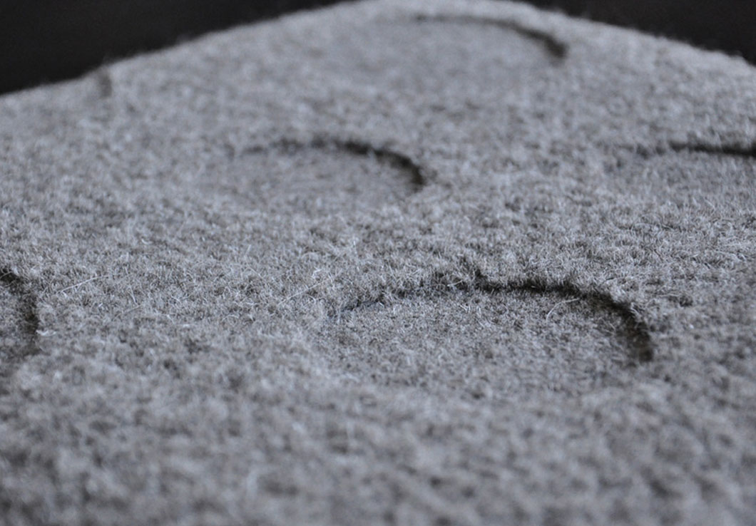 Close-view of our Gaby Rug with a Polka Dot Pattern Hand Carved on the Wool Surface | Urba Rugs