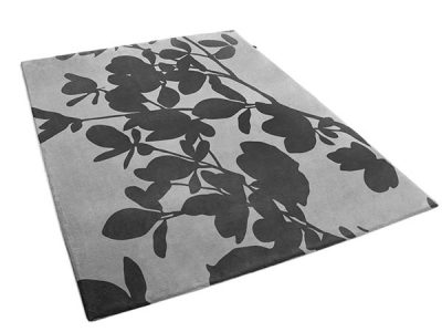 Bella Rug : A black carpet with a floral pattern made by Urba.ca