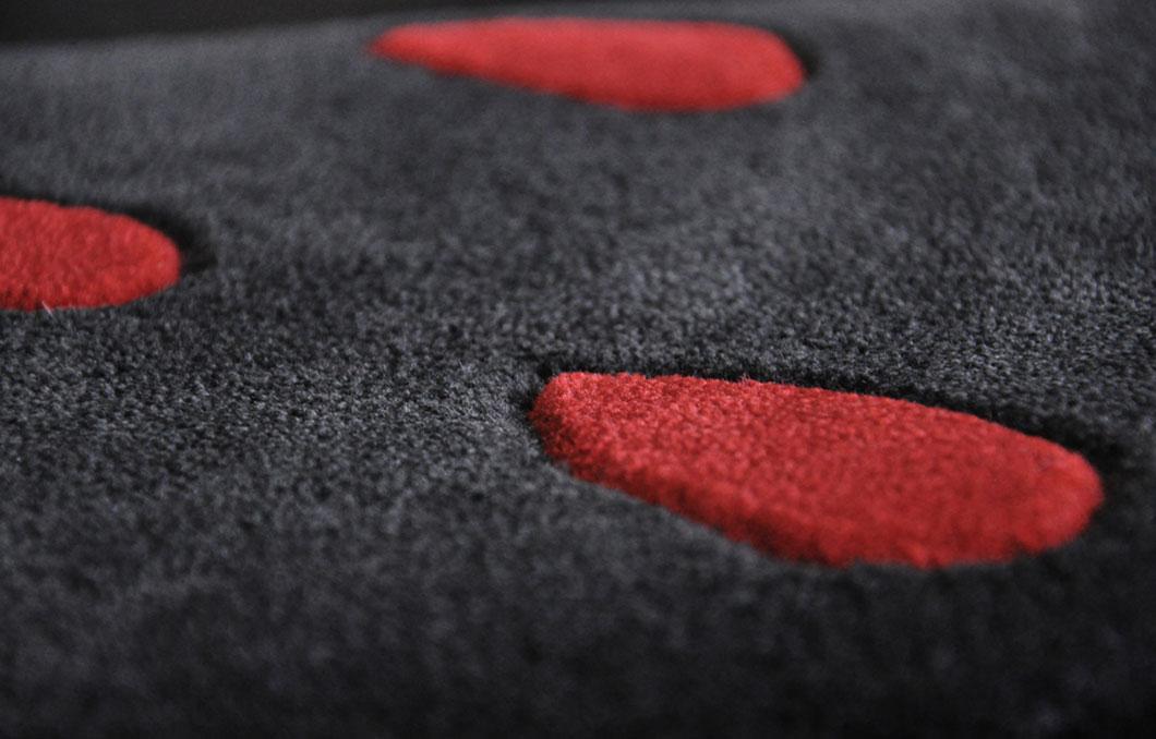 A close-view of our Zora rug featuring a Hand-Carved drop pattern | Urba Rugs