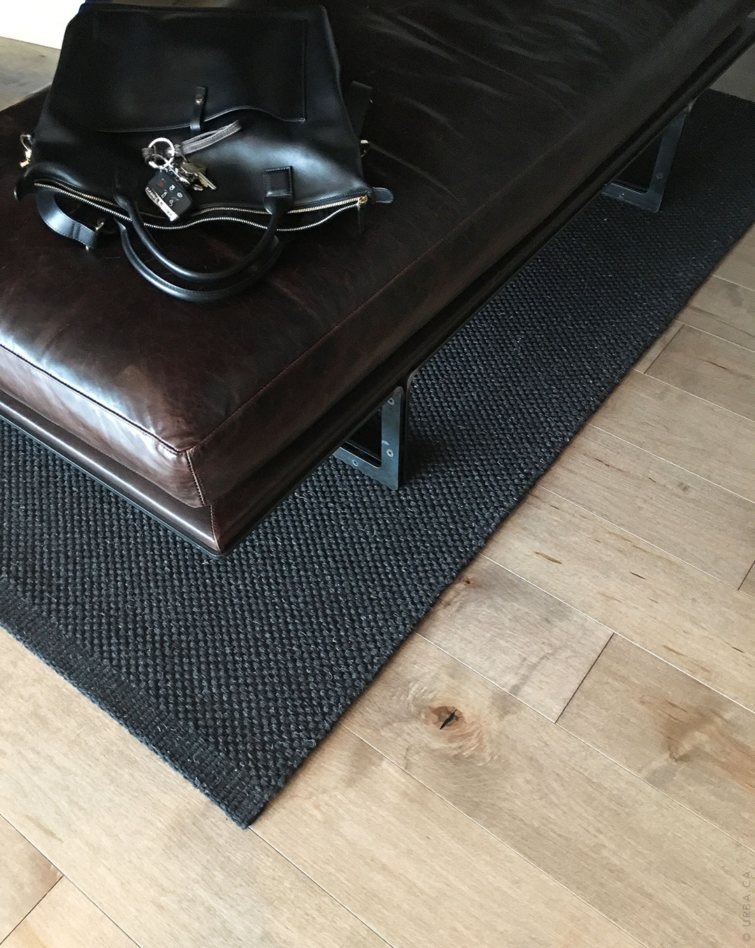 Black Hand Woven Rug Made From Natural Wool in a Modern Entrance | Custom Rug Montreal | Urba Rugs Canada